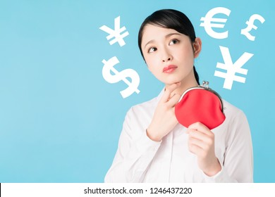 Young asian girl holding a coin purse.