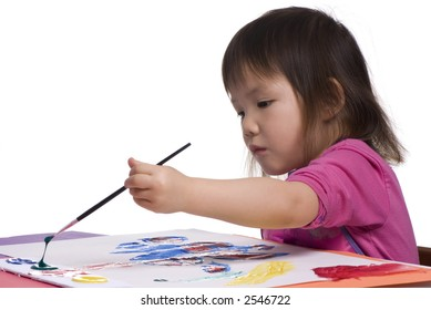 A young asian girl paints her masterpiece