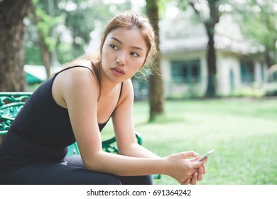 Young Asian Girl resting after exercise