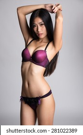 Young asian girl in sexy purple underwear