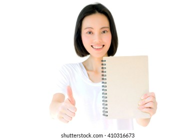 Young Asian girl show thumb isolated on white background.