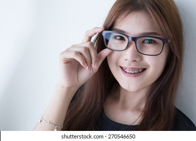 Young asian girl smiling and glasses in black shirt