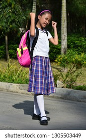 Young Asian Girl Student And Muscles Wearing Uniform With Books