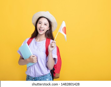 Young asian girl  student showing the  japan flag