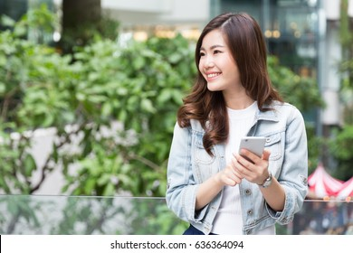 Young Asian Girl using smartphone