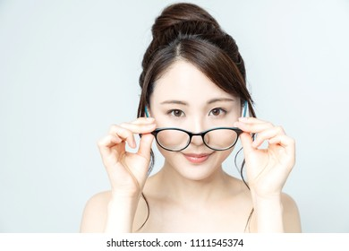 Young asian girl wearing eyeglasses.
