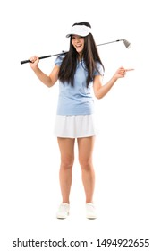 Young asian golfer girl over isolated white background surprised and pointing side
