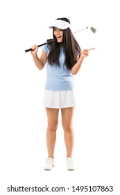 Young asian golfer girl over isolated white background surprised and pointing finger to the side
