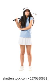 Young asian golfer girl over isolated white background making doubts gesture while lifting the shoulders