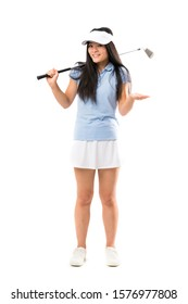 Young asian golfer girl over isolated white background with shocked facial expression