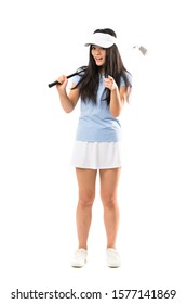 Young asian golfer girl over isolated white background surprised and pointing front