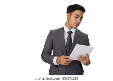 young asian handsome male startup entrepreneur businessman wearing gray suit using  digital tablet touchpad over white background