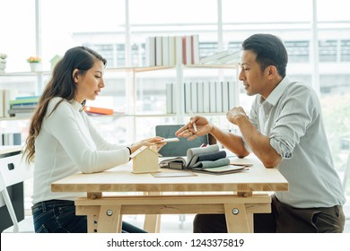 Young asian happiness couple love family male and female talking about house purchase discussing a choice with home plan, real estate and family house concept.house design ideas concept.