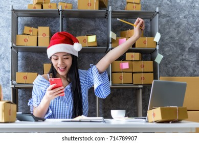 Young Asian happy after new order from customer,own business on shopping online at home office packaging on background is popular.business.online shopping SME entrepreneur freelance working concept.