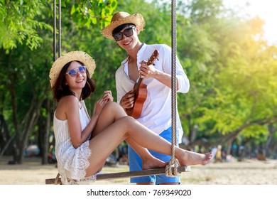 Young Asian happy couple relax on the beach, Couple in love honeymoon vacation and travels concept