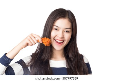 Young Asian happy woman holding and eating fries chicken isolated on white background.