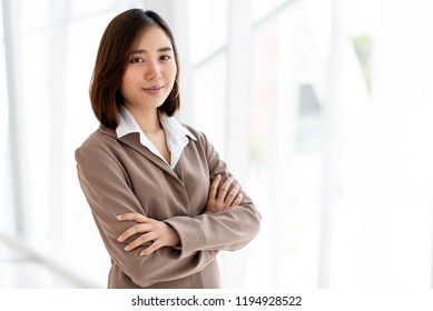 Young Asian happy woman stand in an office