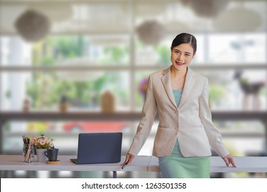 Young Asian happy woman stand in an office.