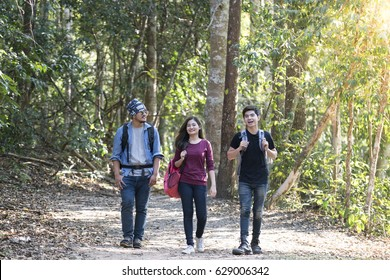 young asian hipster walk to jungle for natural tour.