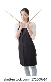 Young Asian housewife hold a chopsticks in apron, closeup portrait on white background.