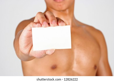 A young asian hunk holding a card