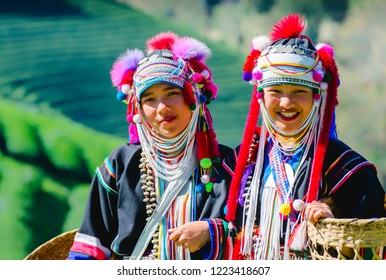 young asian lady Akha tribe,Akha hill standing on the mountain in the morning, Chiang Rai Thailand