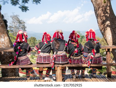 Young asian lady Akha tribe,Akha hill sitting with back view on the wooden floor ,mountain view background in Chiangrai,Thailand - Image