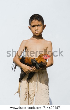 A Young Asian Local Boy Is Enjoy Showering His Fighter Cock Game Cock In