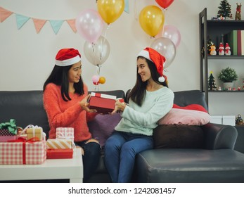 young Asian lovely girls with gift box Christmas party in  living room  happy time