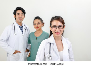 Young asian malay chinese male female doctor on white background smile confident looking at camera