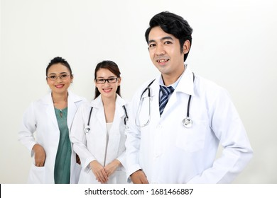 Young asian malay chinese male female doctor on white background posing looking at camera