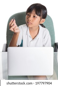 Young Asian Malay school girl in school uniform with a laptop over white background
