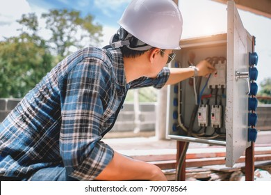 The young asian male engineers was being checked for enterprise engineering, electrical conversion to safety in a building under construction,Engineer concept,Off-site engineering concept .