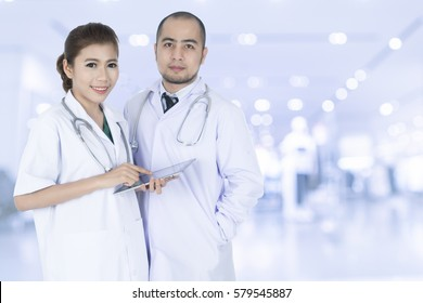 Young Asian male and female doctors with clipping path.