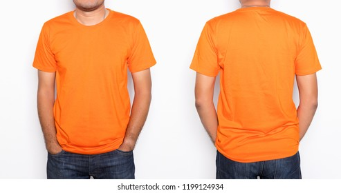 Young Asian man in a blank orange t-shirt on white background.