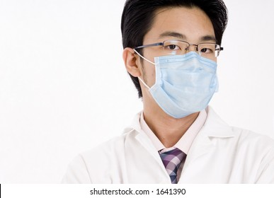 A young asian man in blue face mask and white coat
