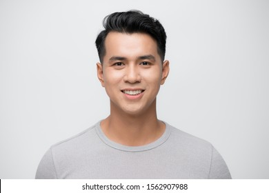 Young Asian man close up shot isolated on white