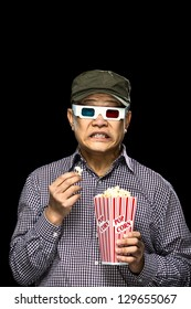 A young Asian man comically reacting to a horror film.