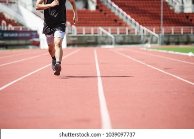 Young Asian man doing exercise in the summer
