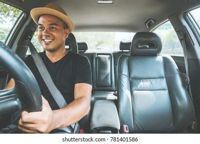 Young asian man driving car.