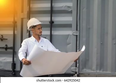 Young Asian man engineer wearing safety white helmet in white shirt checking construction site building,He is stressed.