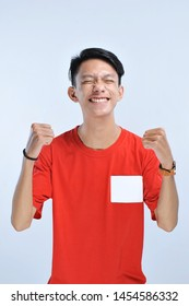 Young asian man happy and excited expressing winning gesture. Successful and celebrating on grey background