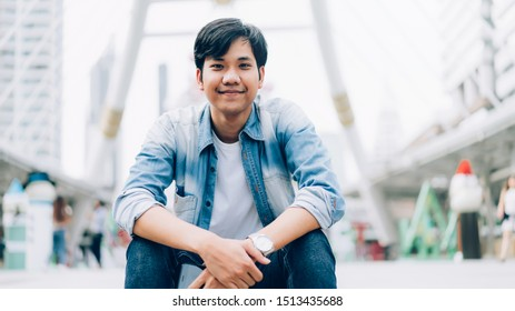 Young Asian man of happy smiling and sitting in office building.