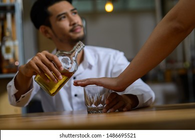Young Asian man has been stop for drinking alcohol may be because of during quit alcohol period or it is illegal to drive vehicle after drink alcohol.