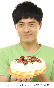 Young asian man holding birthday cake