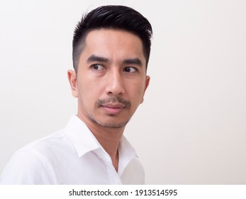 Young Asian man isolated on white background looking sideways