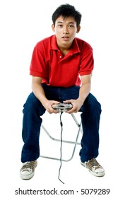 Young Asian man playing with video game on white background