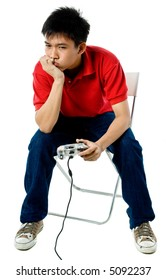A young Asian man playing video game on white background