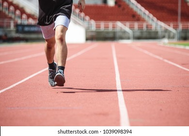Young Asian man practice running in the summer