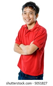 A young Asian man in red top and jeans on white background
